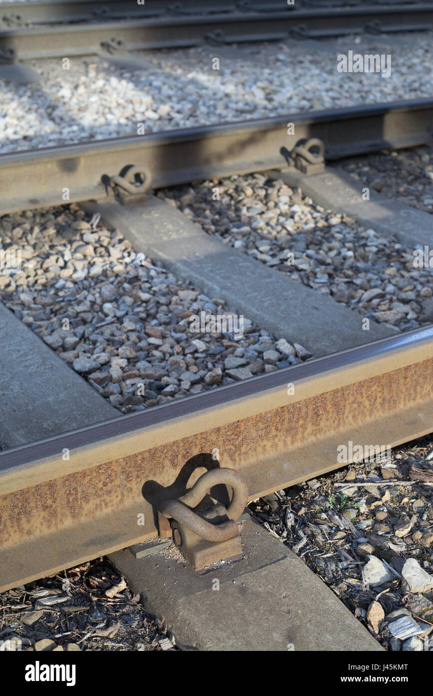 Pandrol clip, part of the  railway fastening system on the Calgary C Train tracks - Stock Image