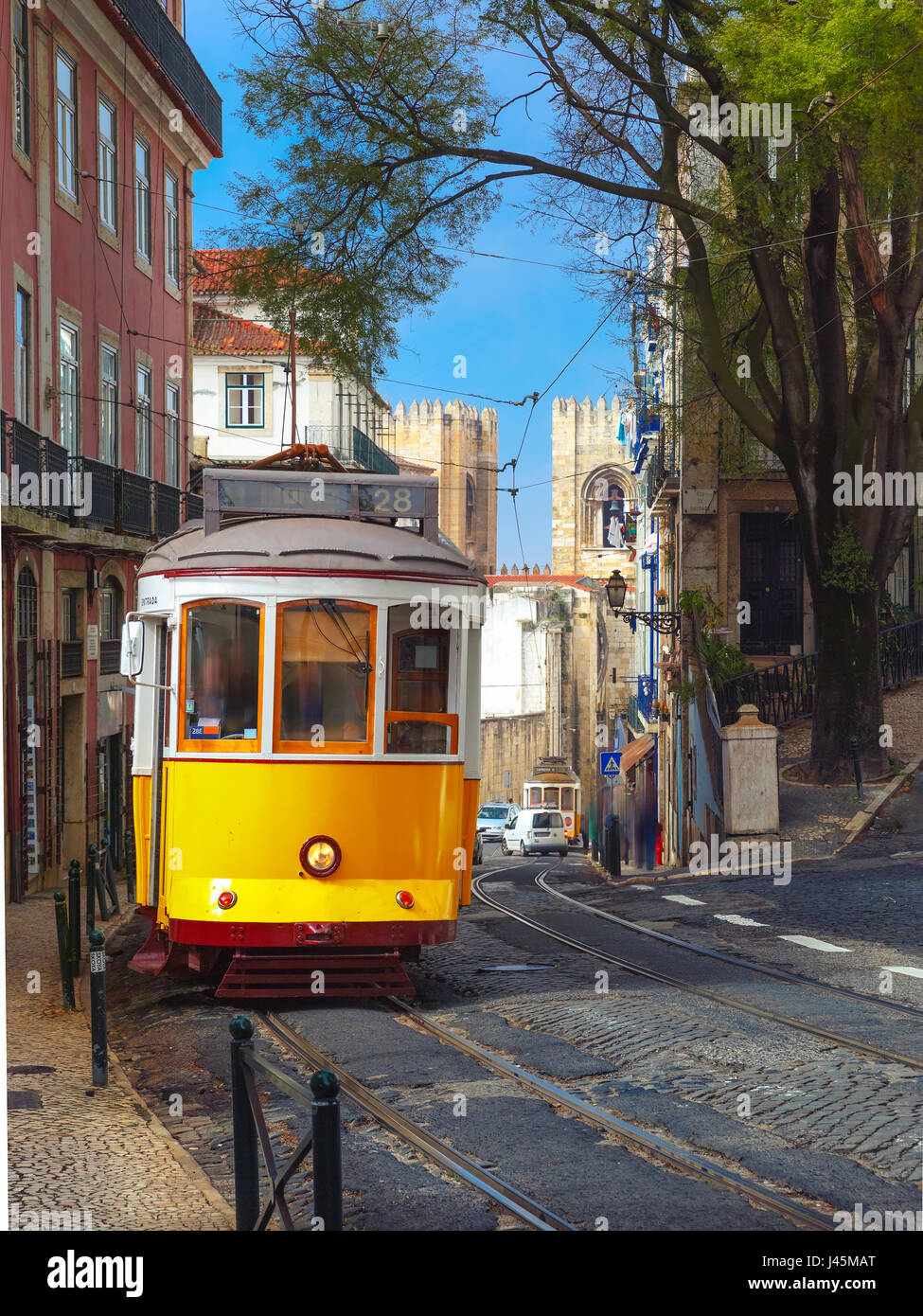 Yellow 28 tram in Alfama, Lisbon, Portugal - Stock Image