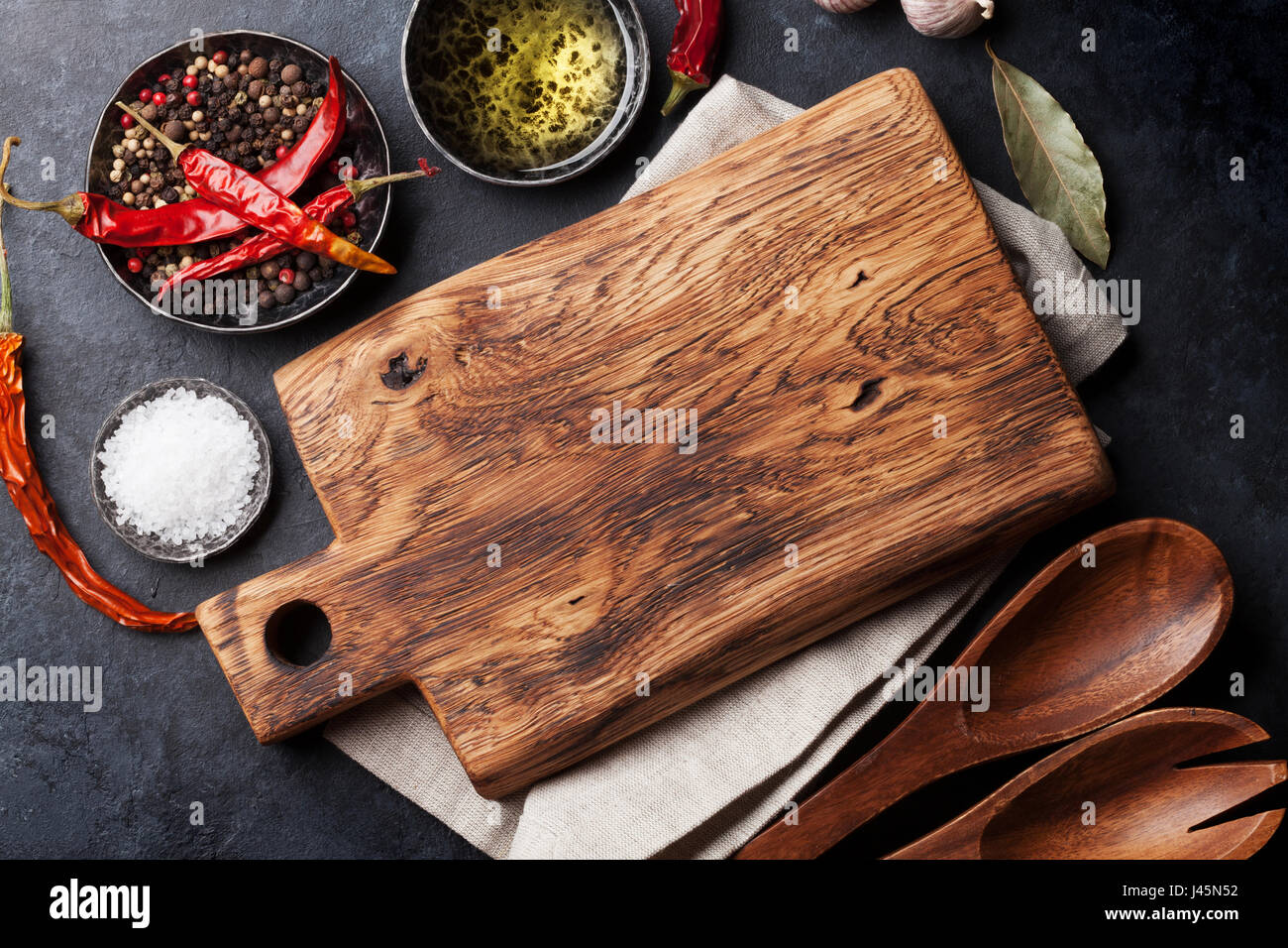 Cooking ingredients and utensils on stone table. Top view - Stock Image