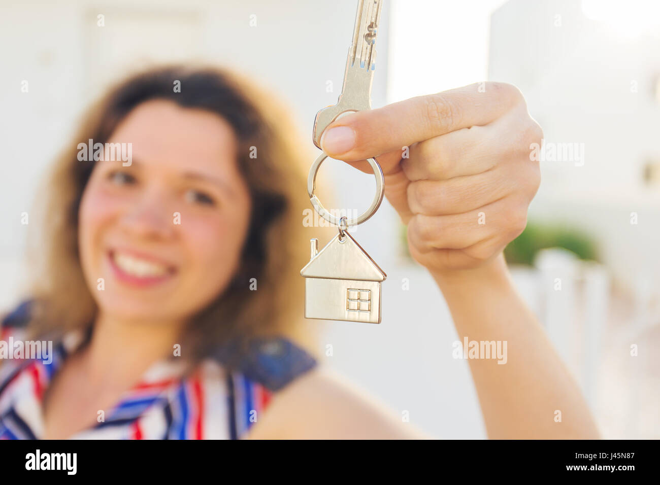 Close Up Of Happy House Owner Or Renter Showing Keys And Looking At You