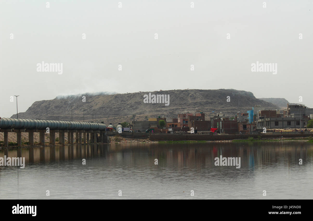 Bhalswa landfill site behind Bhalswa lake in Northwest Delhi, India - Stock Image