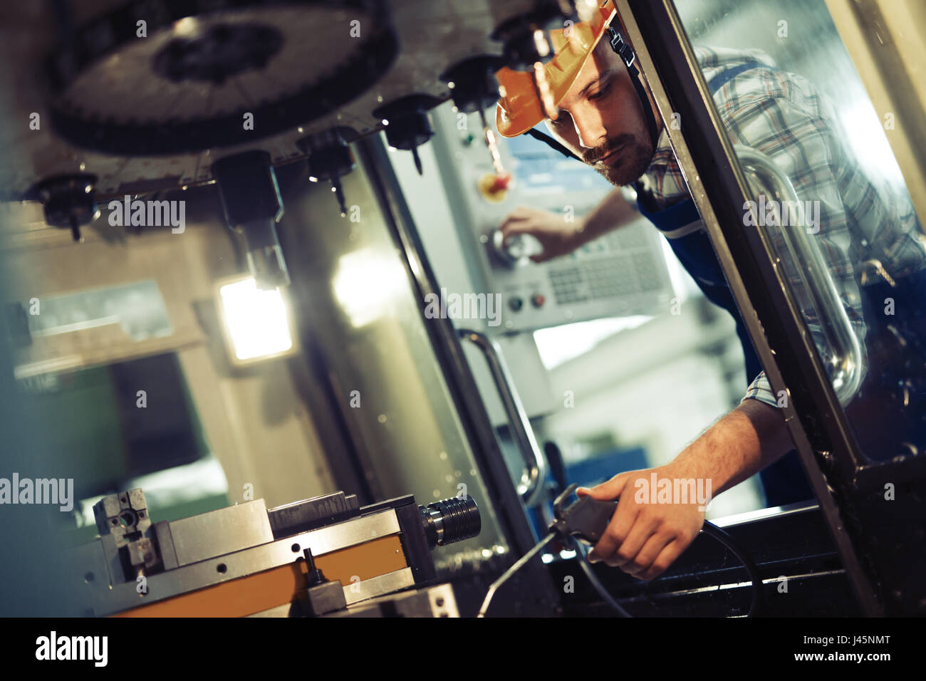 industrial factory worker working in metal manufacturing industry Stock Photo