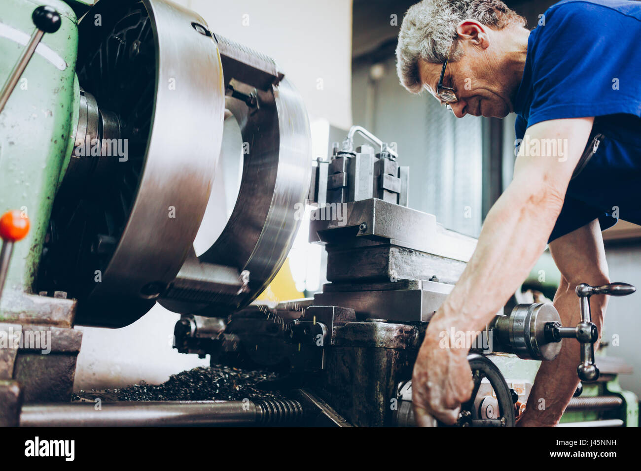 industrial factory worker working in metal manufacturing industry - Stock Image