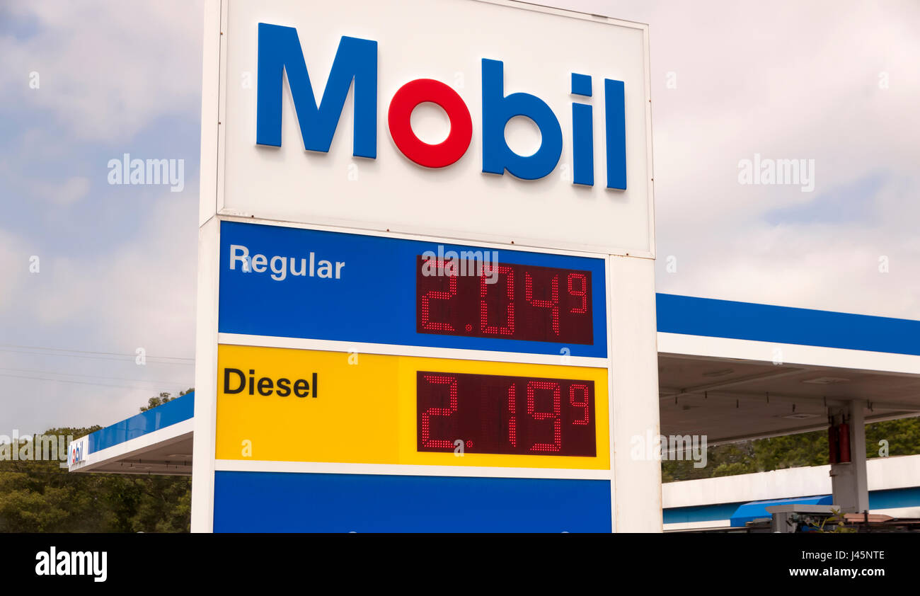 Mobil sign advertising very low prices at a gasoline station. - Stock Image