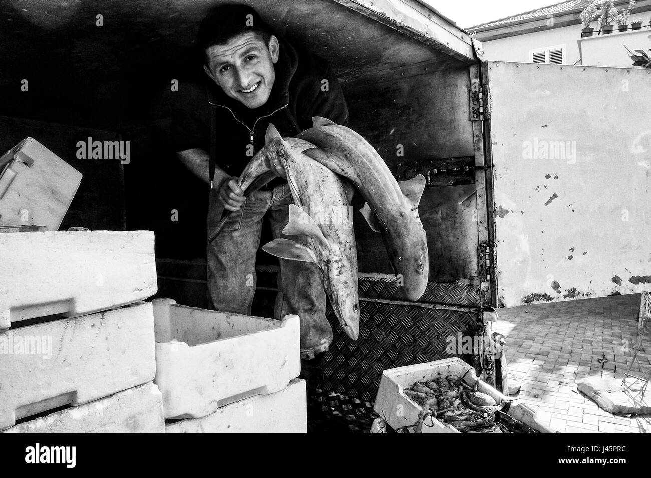 Tirane, Albania. 3rd May, 2017. A man delivers fresh fish to a restaurant in an unrefrigerated truck in the capital - Stock Image