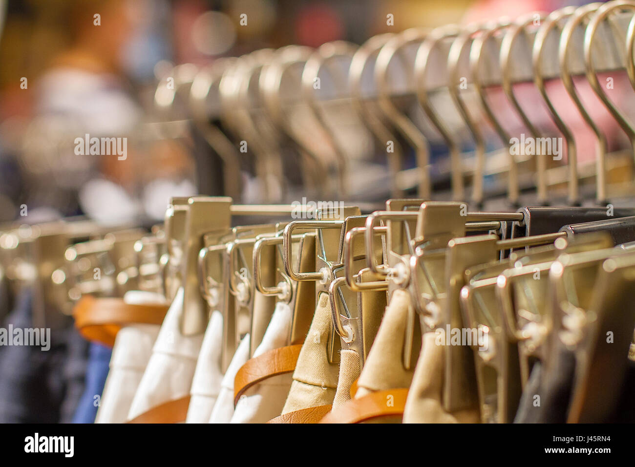 a Preview ladies skirts hanging on display c - Stock Image