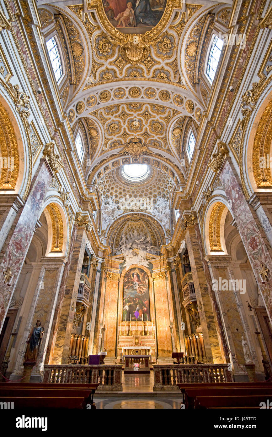 Interior wide angle view of the main alter in the San Luigi dei Francesi Church in Rome. - Stock Image