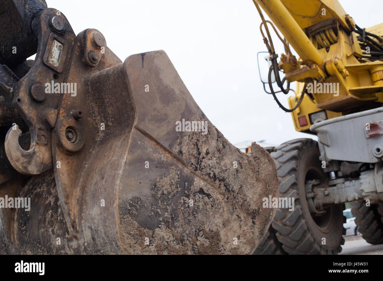 Dirty bucket of an excavator. Stock Photo