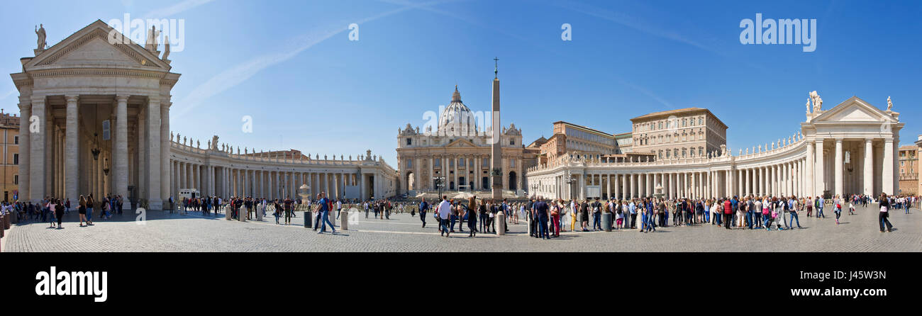 A 4 picture stitch panoramic view of St. Peter's Square in front of St Peters Basilica with crowds of tourists - Stock Image