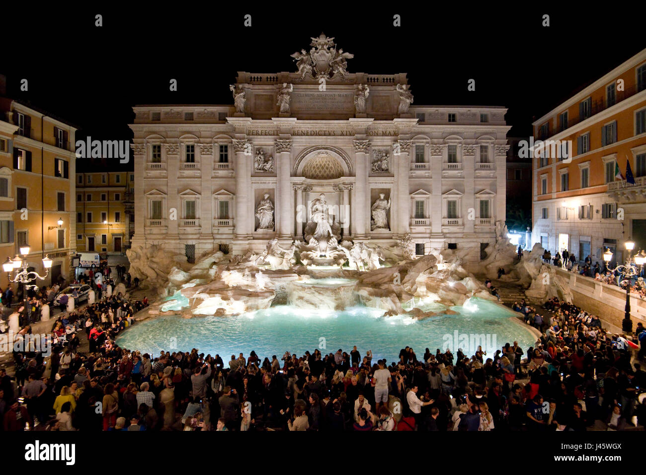 """An aerial view of The Trevi Fountain """"Fontana di Trevi"""" in Rome with crowds of tourists and visitors at night. Stock Photo"""