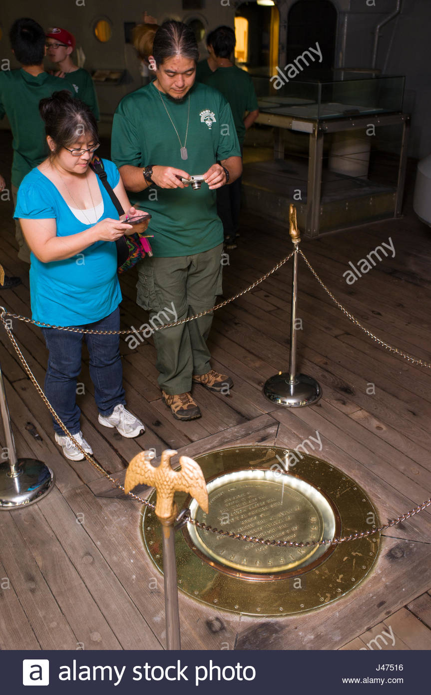 Man and woman photographing the plaque where the Surrender of Japan occurred September 2, 1945 aboard the U.S.S. - Stock Image