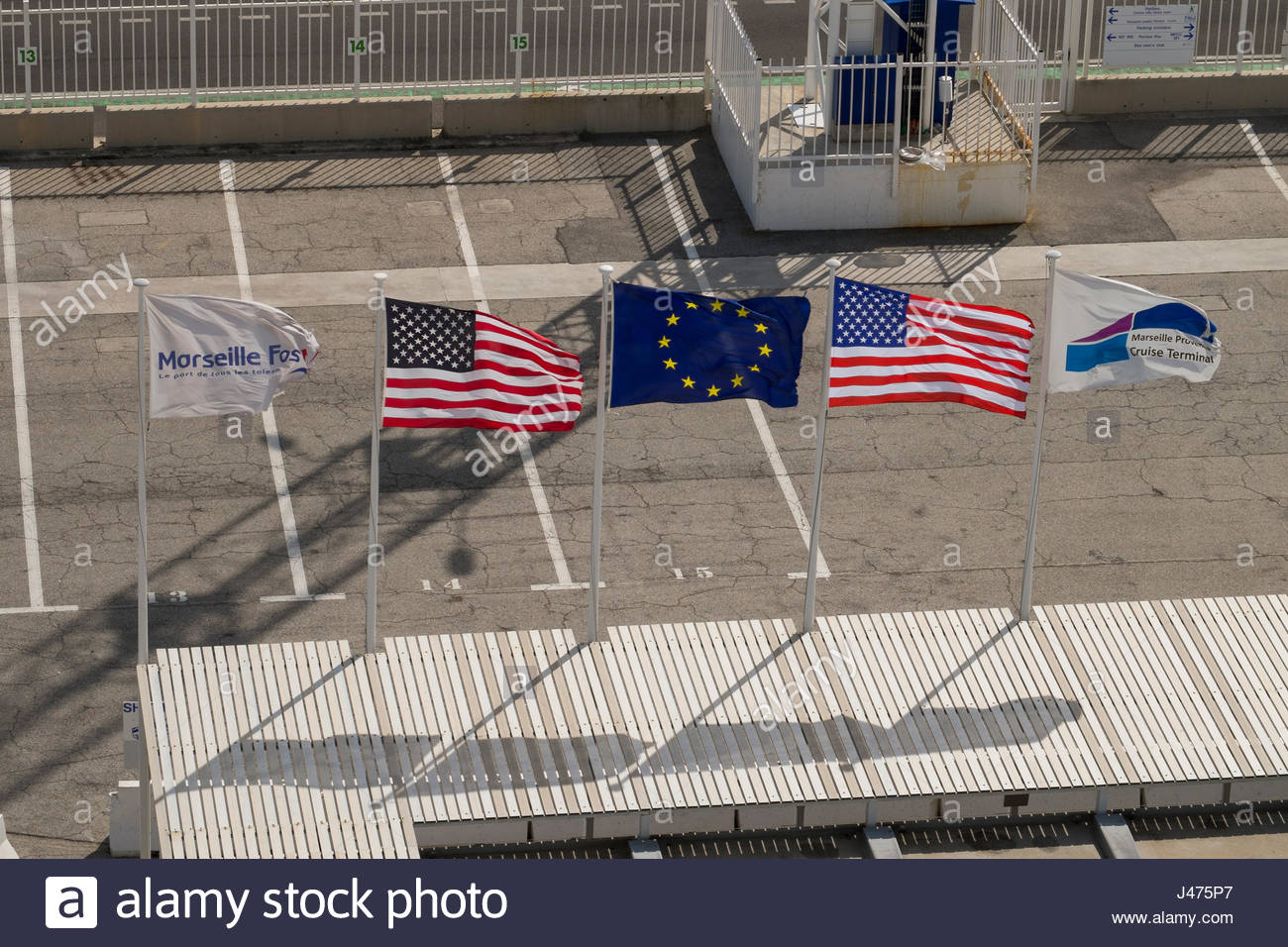 United States flag and the European Union flags flying at the Marseille Provence cruise terminal, madrague-ville, - Stock Image