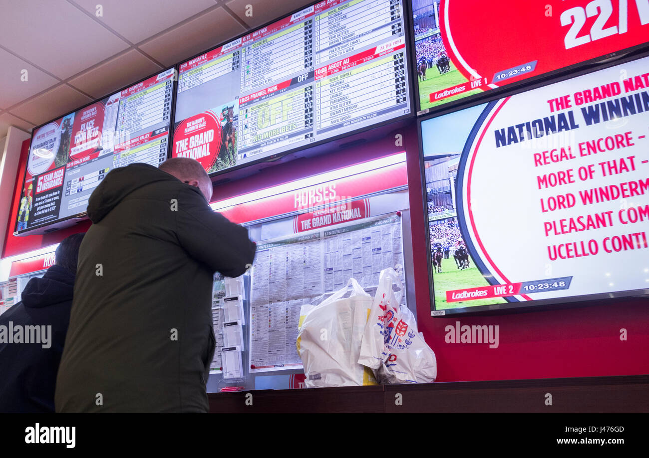 Ladbrokes betting shop, bookies, on Grand National day. UK - Stock Image