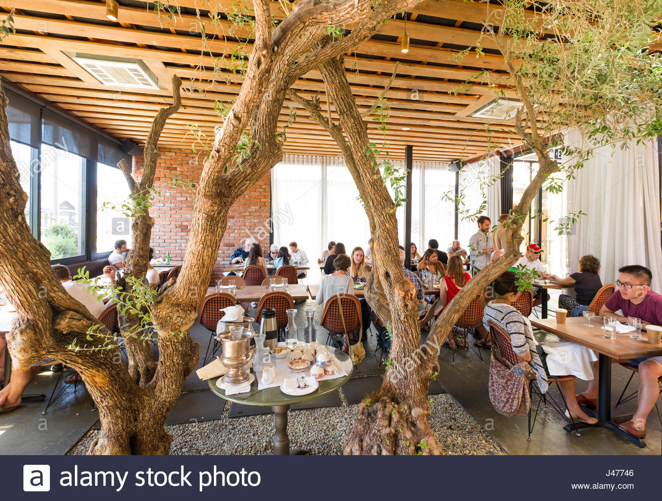 """People sitting at tables in """"The Tasting Kitchen"""" restaurant ..."""