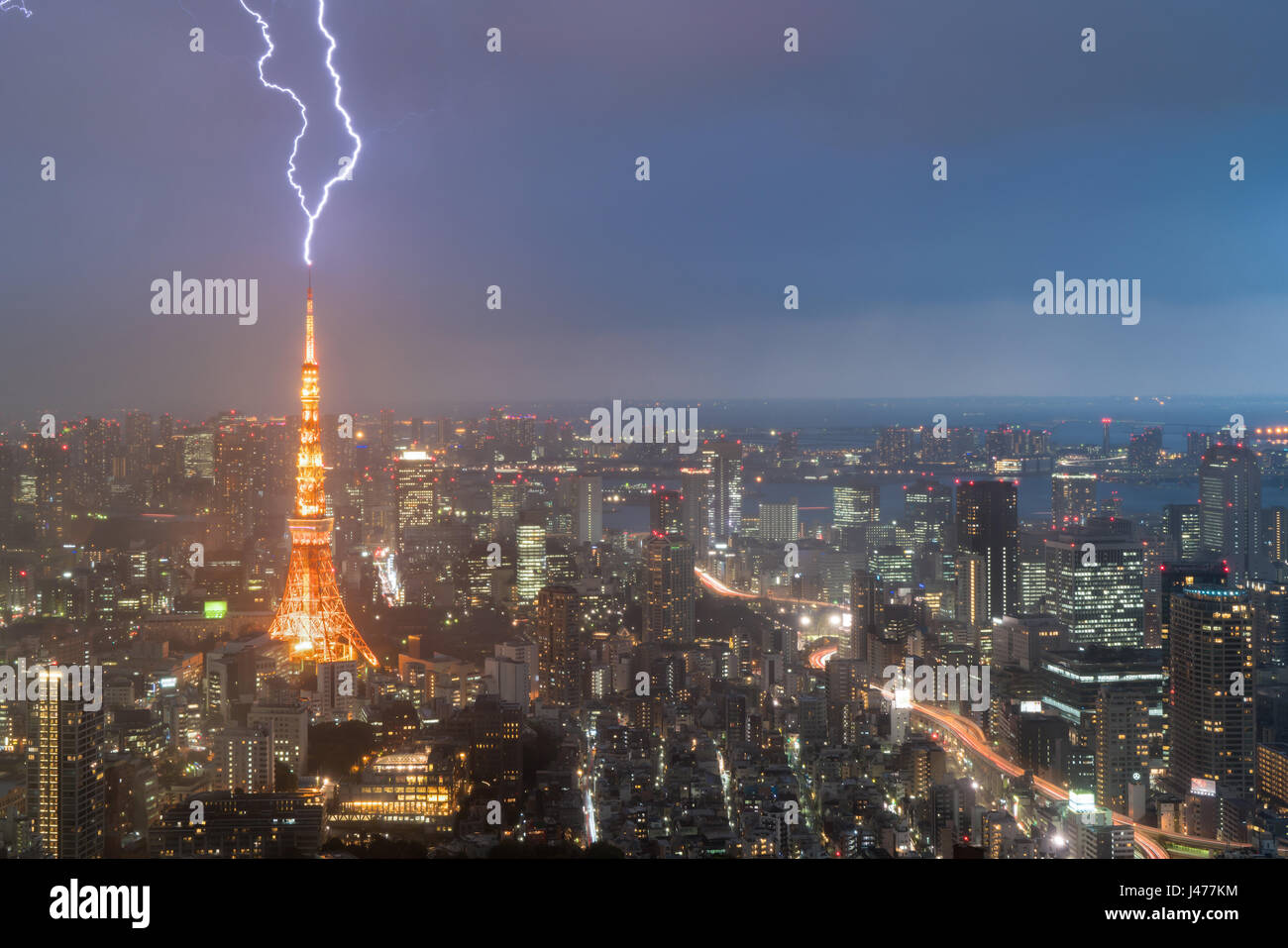 Lightning storm over Tokyo city, Japan in night with thunderbolt over Tokyo tower. Thunderstorm in Tokyo, Japan. - Stock Image