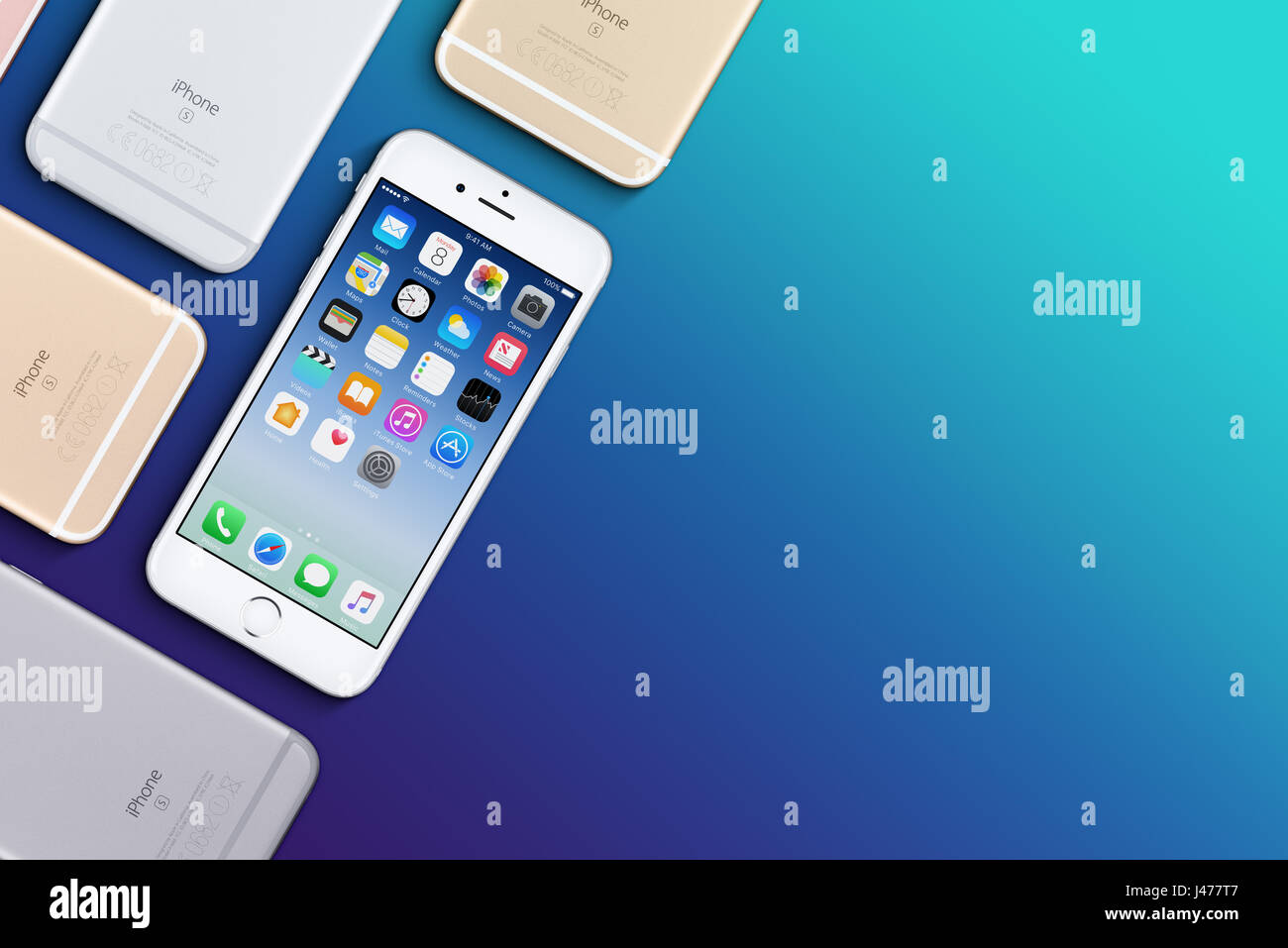 Set of multicolored Apple iPhones 6s flat lay top view lies on surface with copy space - Stock Image