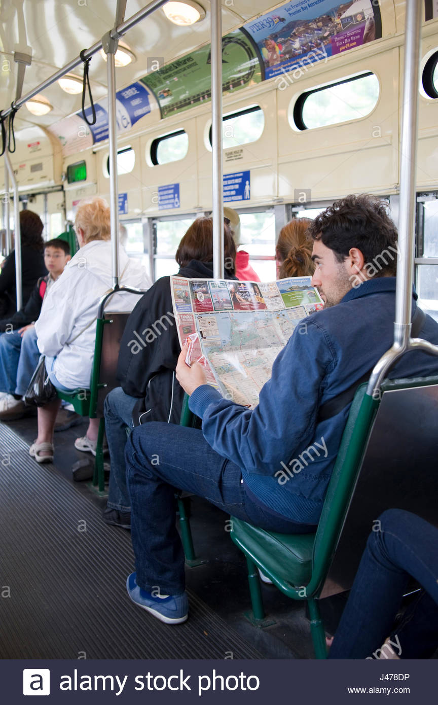 Trolley Cars San Francisco Map.Man Looking At Map Sitting Inside The Historic F Line Streetcar