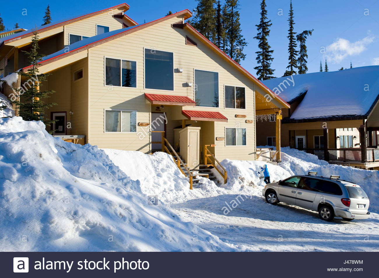 Snow covered homes along lower snow pines road big white british columbia canada