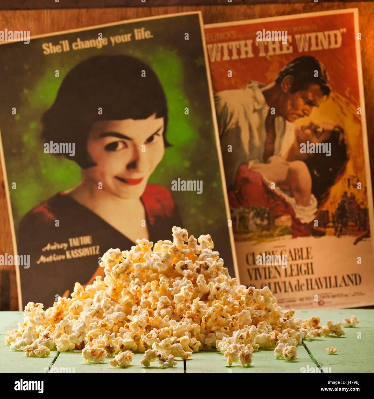 Classic film concept - a pile of popcorn with two classic film posters in the background - Stock Image