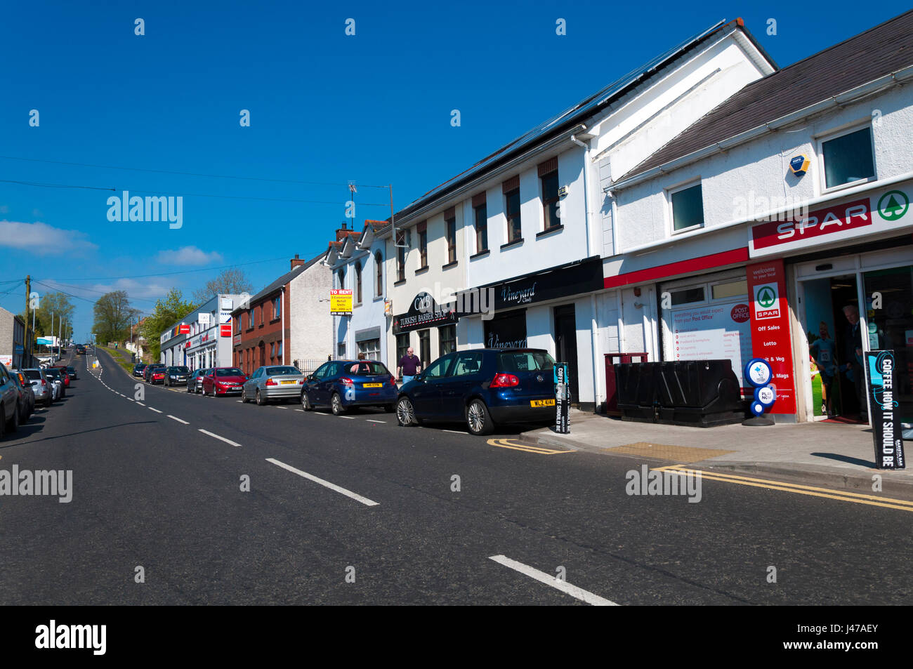 Main Street. The Claudy bombing occurred on 31 July 1972, when three car bombs exploded mid-morning on the Main - Stock Image