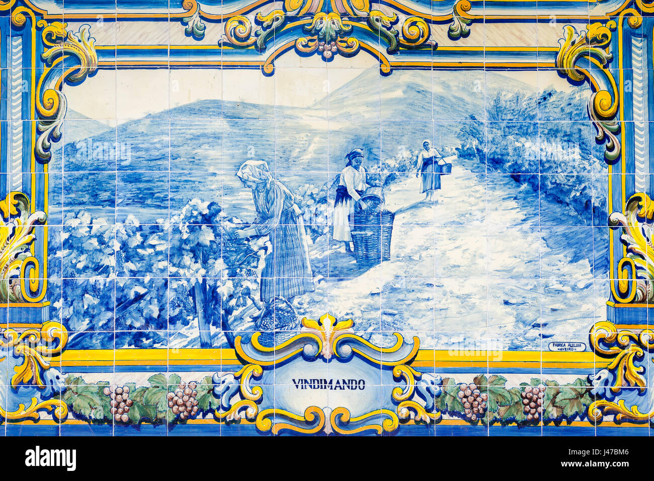 Portugal tiles, one of a series of 10 scenes in blue azulejos tiles depicting the Douro Valley port wine harvest - Stock Image
