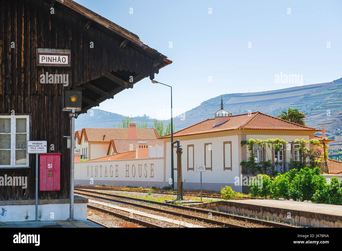 Pinhao Portugal train station, train station platform and adjacent vintage house in the Douro Valley port wine town - Stock Image