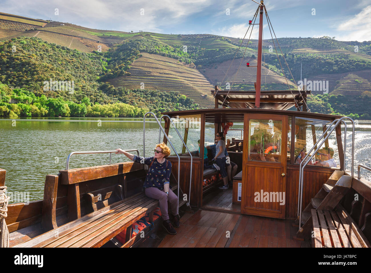 Douro River Valley, tourists in the Douro Valley tour the Rio Douro in a traditional rabelo boat, Portugal. - Stock Image
