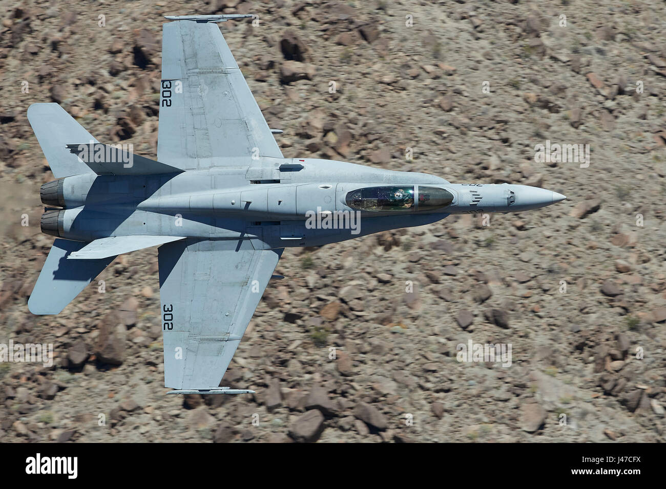 United States Navy F/A-18C, Hornet, Flying At High Speed And Low Level, Through A Desert Canyon. - Stock Image