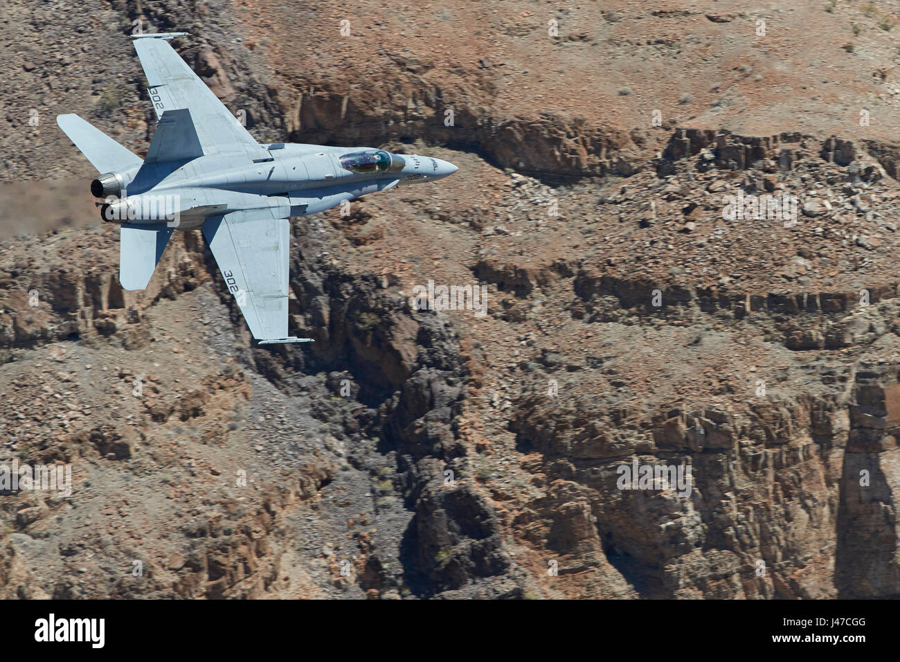 United States Navy F/A-18C, Hornet, Flying At High Speed And Low Level. Through A Desert Canyon. - Stock Image