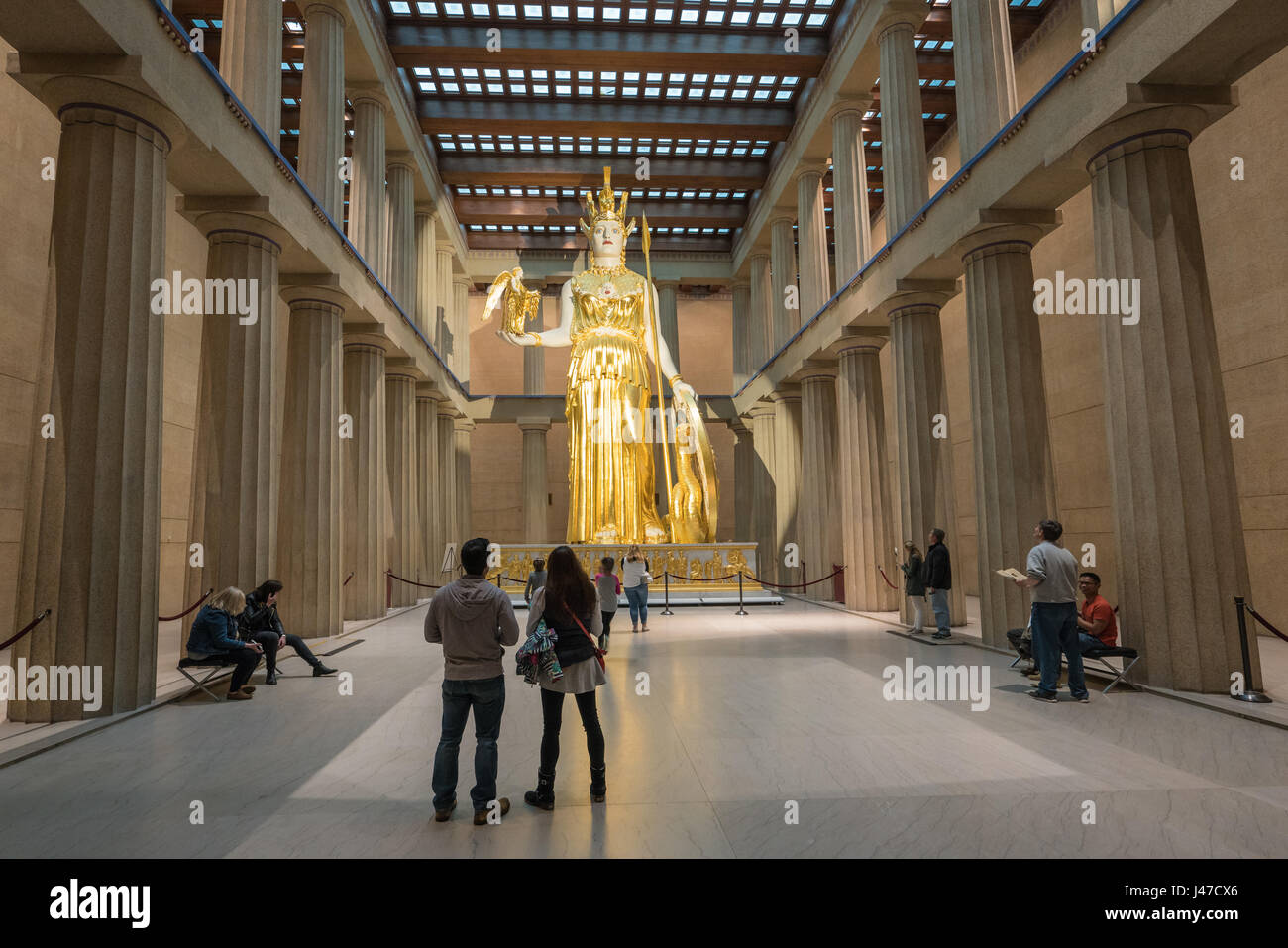 Huge golden homage to the statue of Athena Parthenos gleams in the Parthenon, Nashville - Stock Image