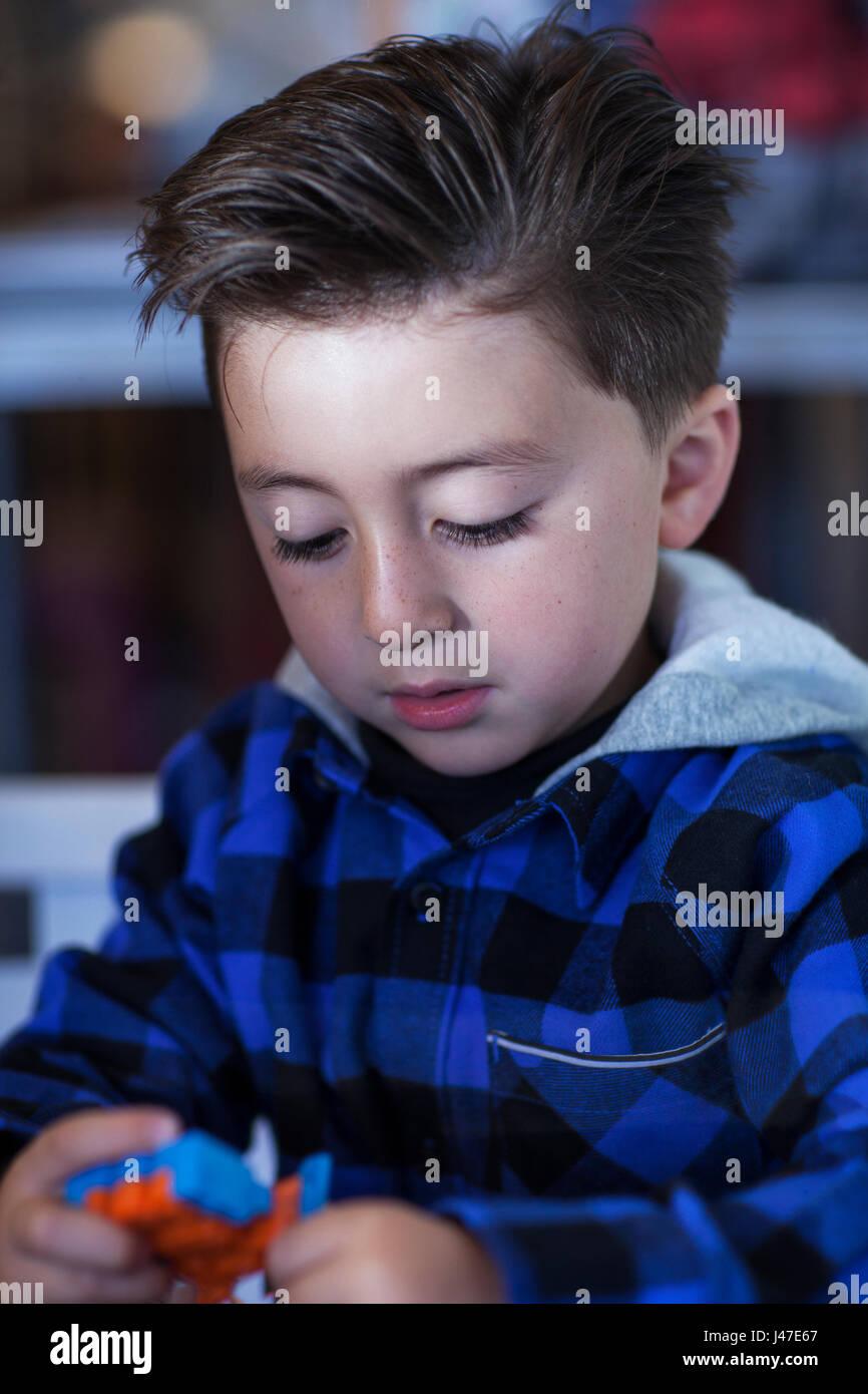 Little Boy With A Greaser Rockabilly Haircut Undercut Wearing A Blue
