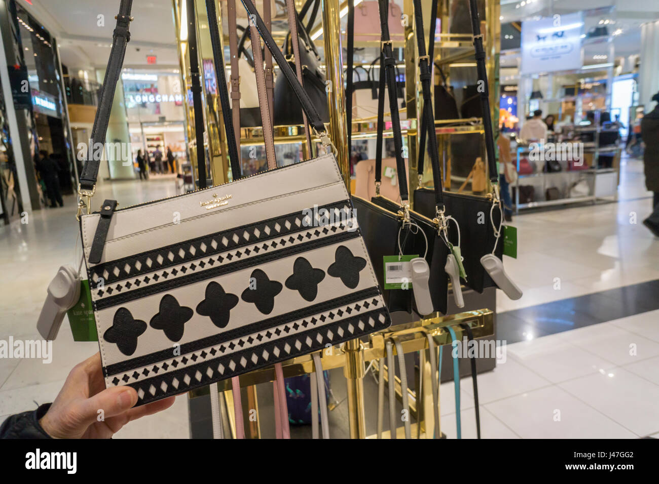 The Kate Spade boutique within Macy's department store in New York with the Coach boutique behind it on Monday, - Stock Image