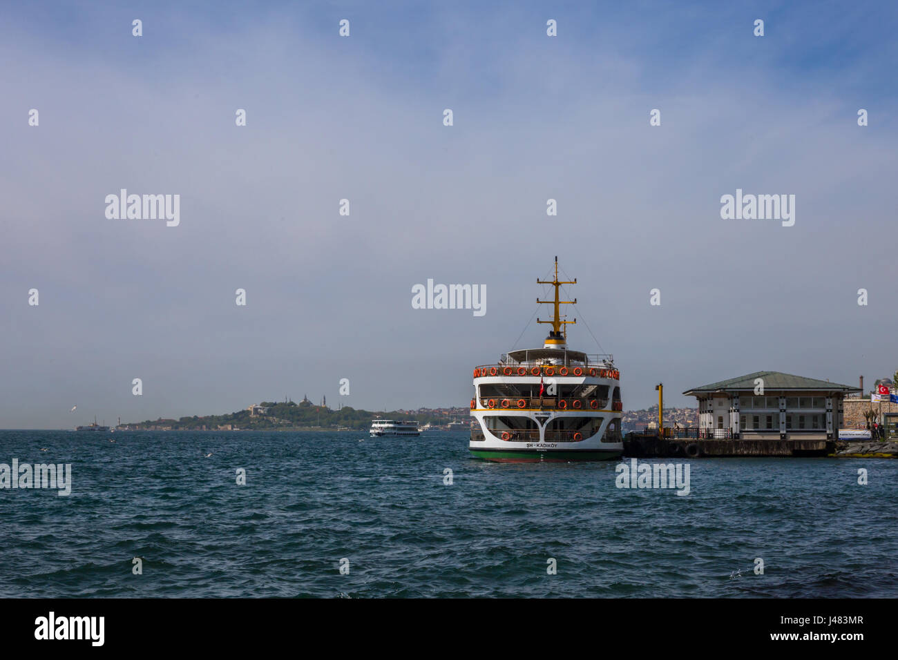Istanbul ferry stop at Besiktas Iskele, Istanbul. Ferry waiting for passengers to board. Bosphorus channel view - Stock Image