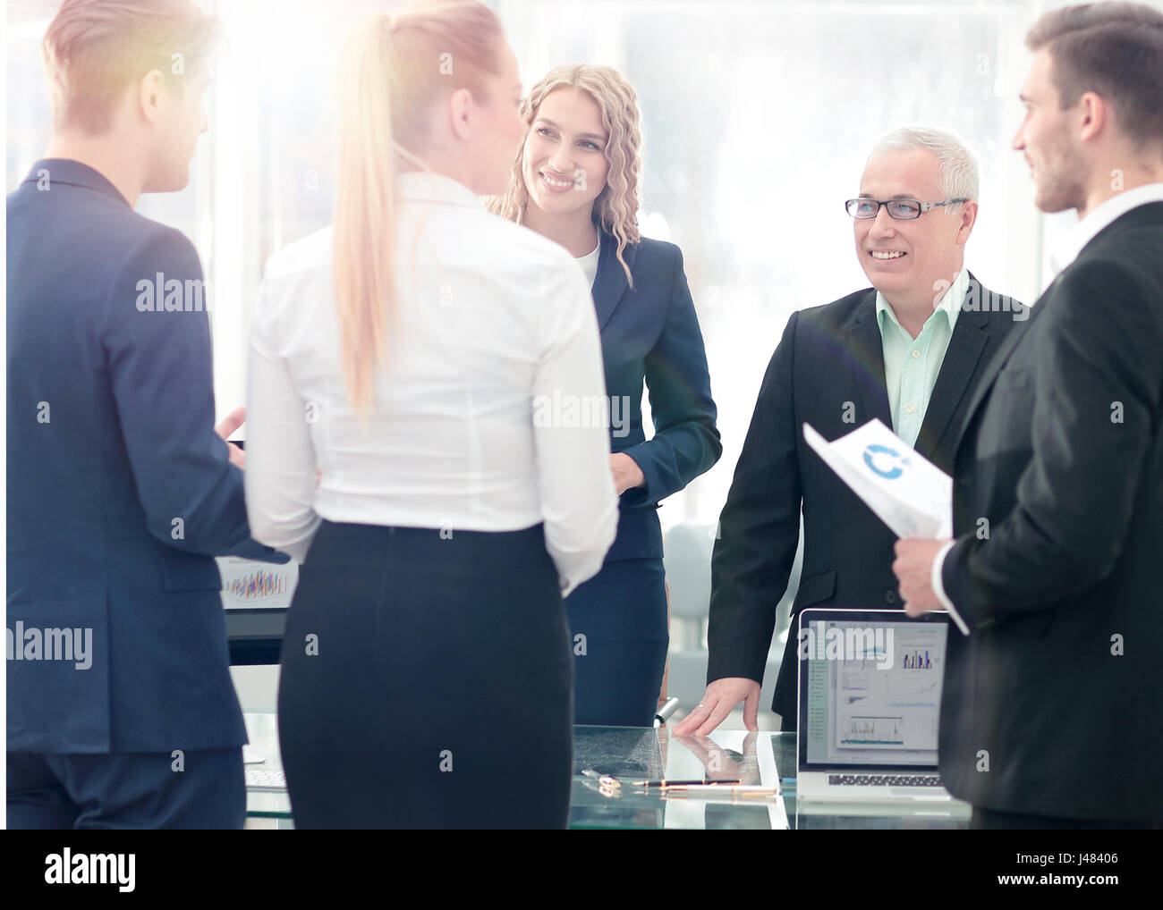 Image of business partners discussing documents and ideas at mee - Stock Image