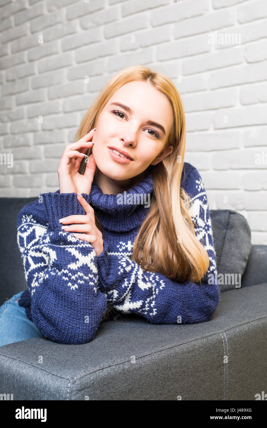 Young woman in casualwear looking at camera - Stock Image