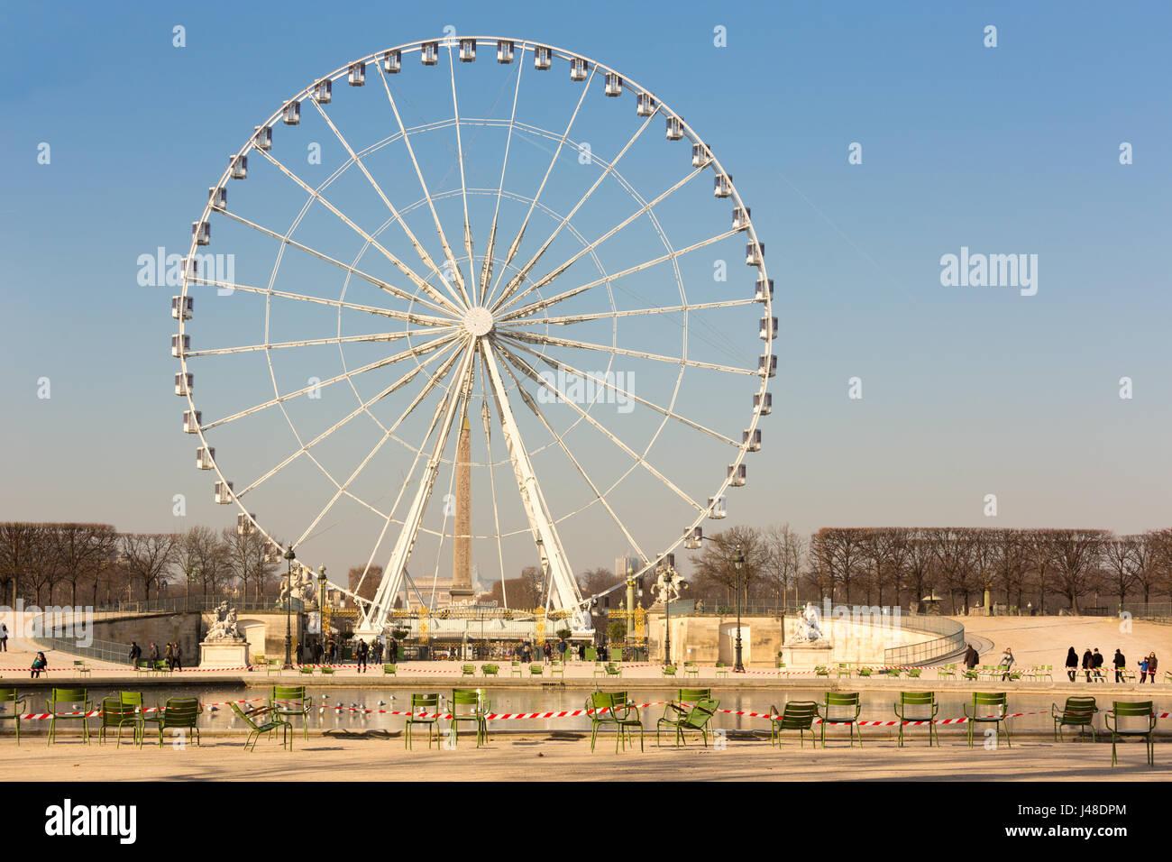 Ferris Wheel in Concorde Square ( Place de la Concorde ) view from Tuieres Garden - Stock Image