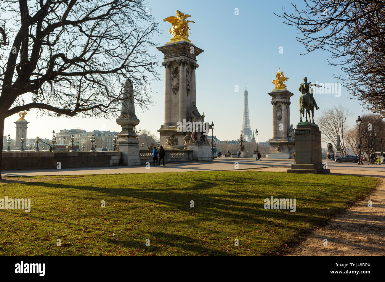 Eiffel tower (Tour Eiffel ) and  Pont Alexandre III  in a sunny day in winter. - Stock Image