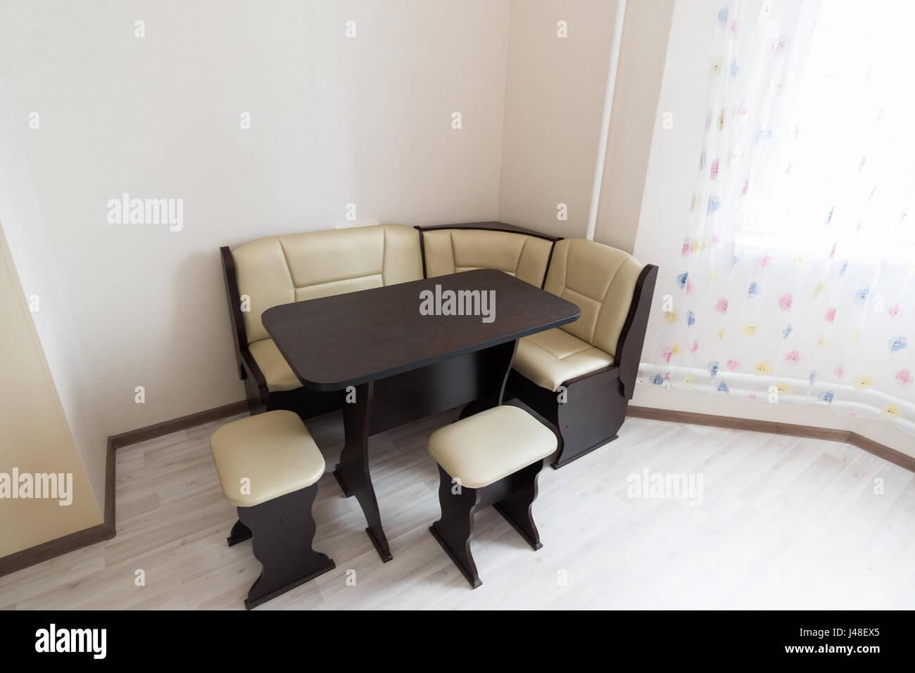 Kitchen corner sofa and table in interior Stock Photo - Alamy