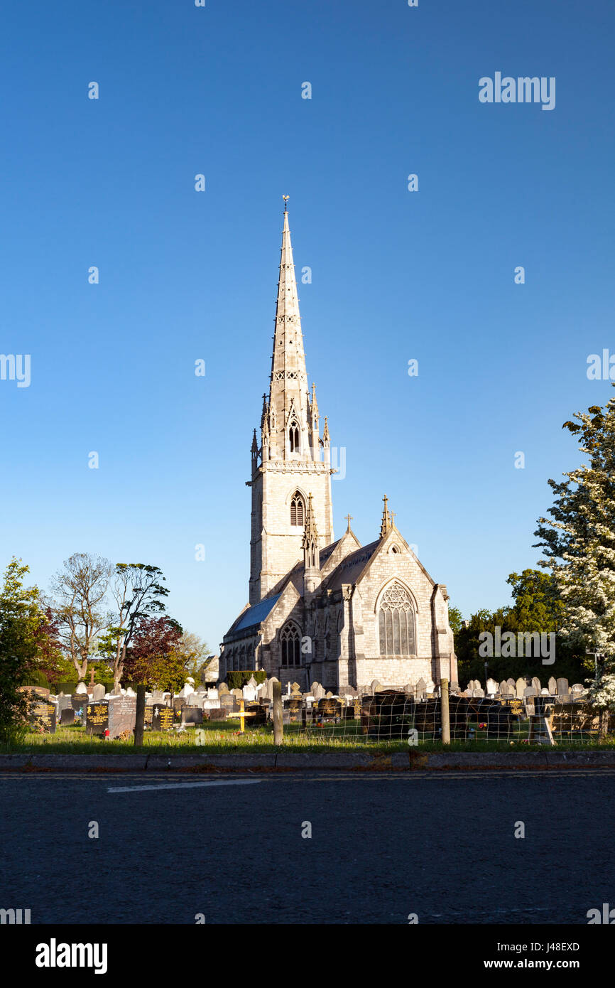 The Gothic styled Marble Church or St Margaret's Church at St Asaph in North Wales set against a cloudless sky - Stock Image