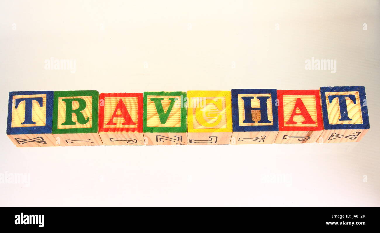 The phrase travchat displayed visually on a white background using colorful wooden blocks Stock Photo