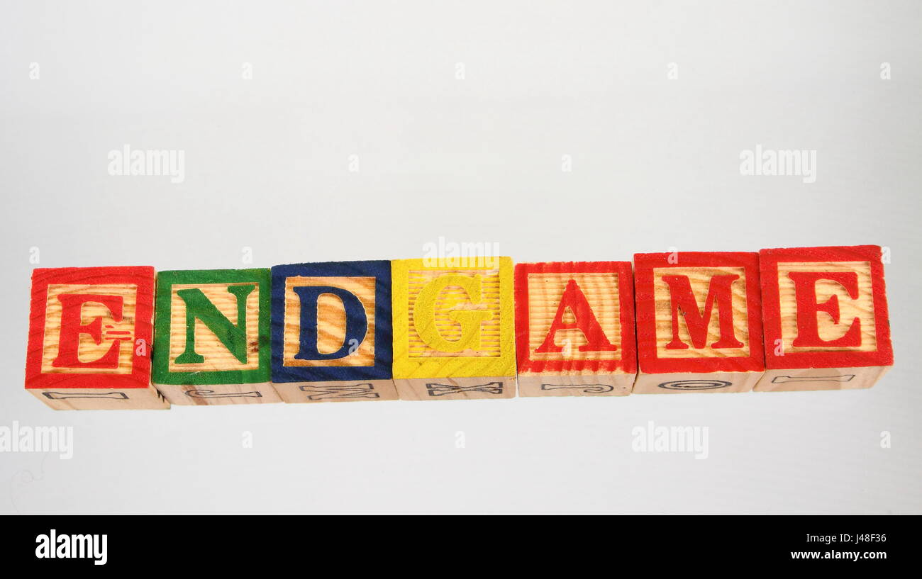 The phrase endgame displayed visually on a white background using colorful wooden blocks - Stock Image