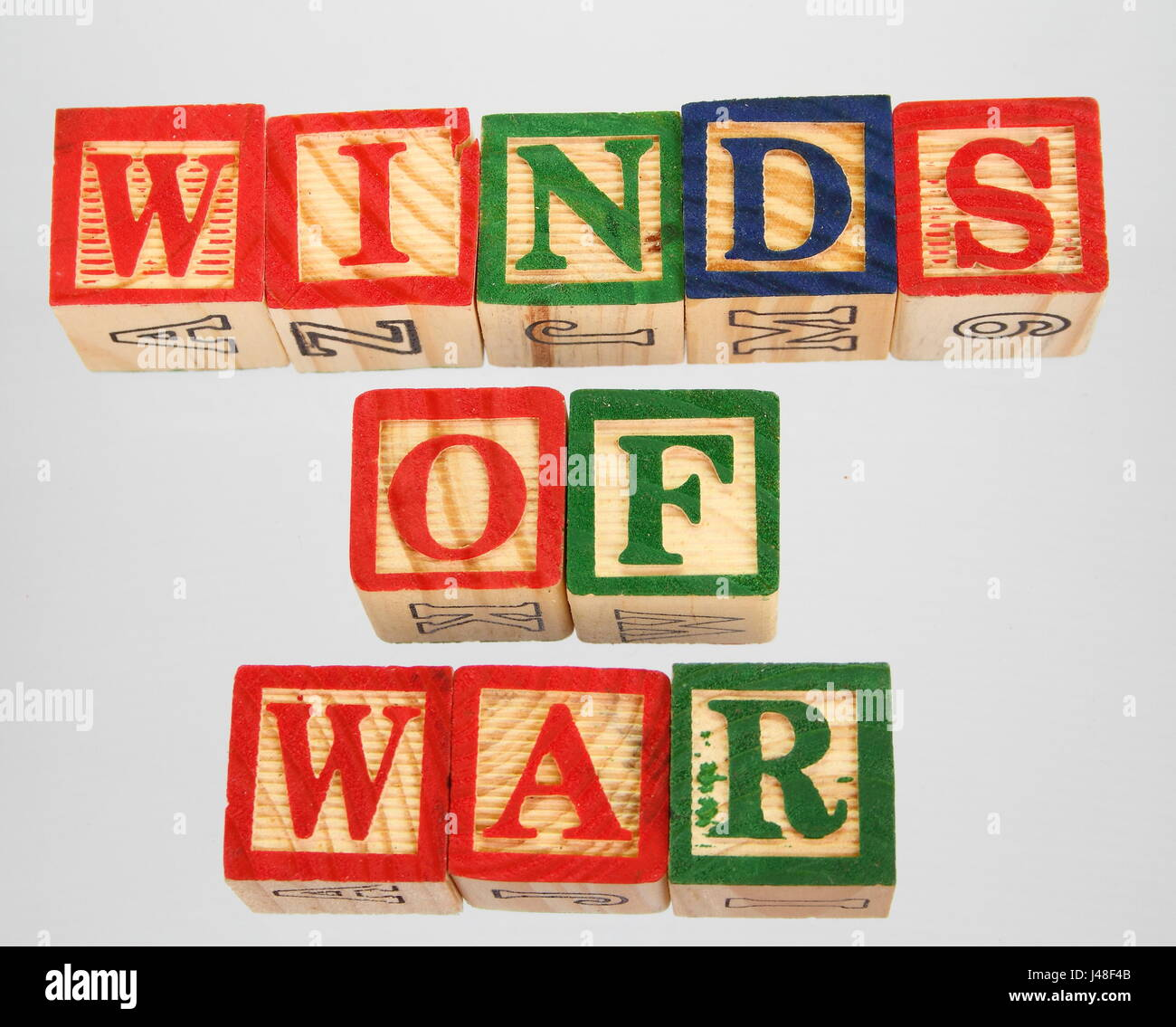The phrase winds of war displayed visually on a white background using colorful wooden blocks Stock Photo