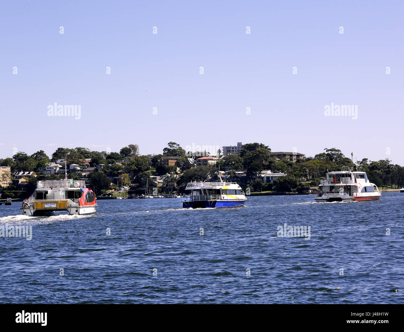 Three siteseeing/cruise boats leaving Darling Harbour, Sydney - Stock Image