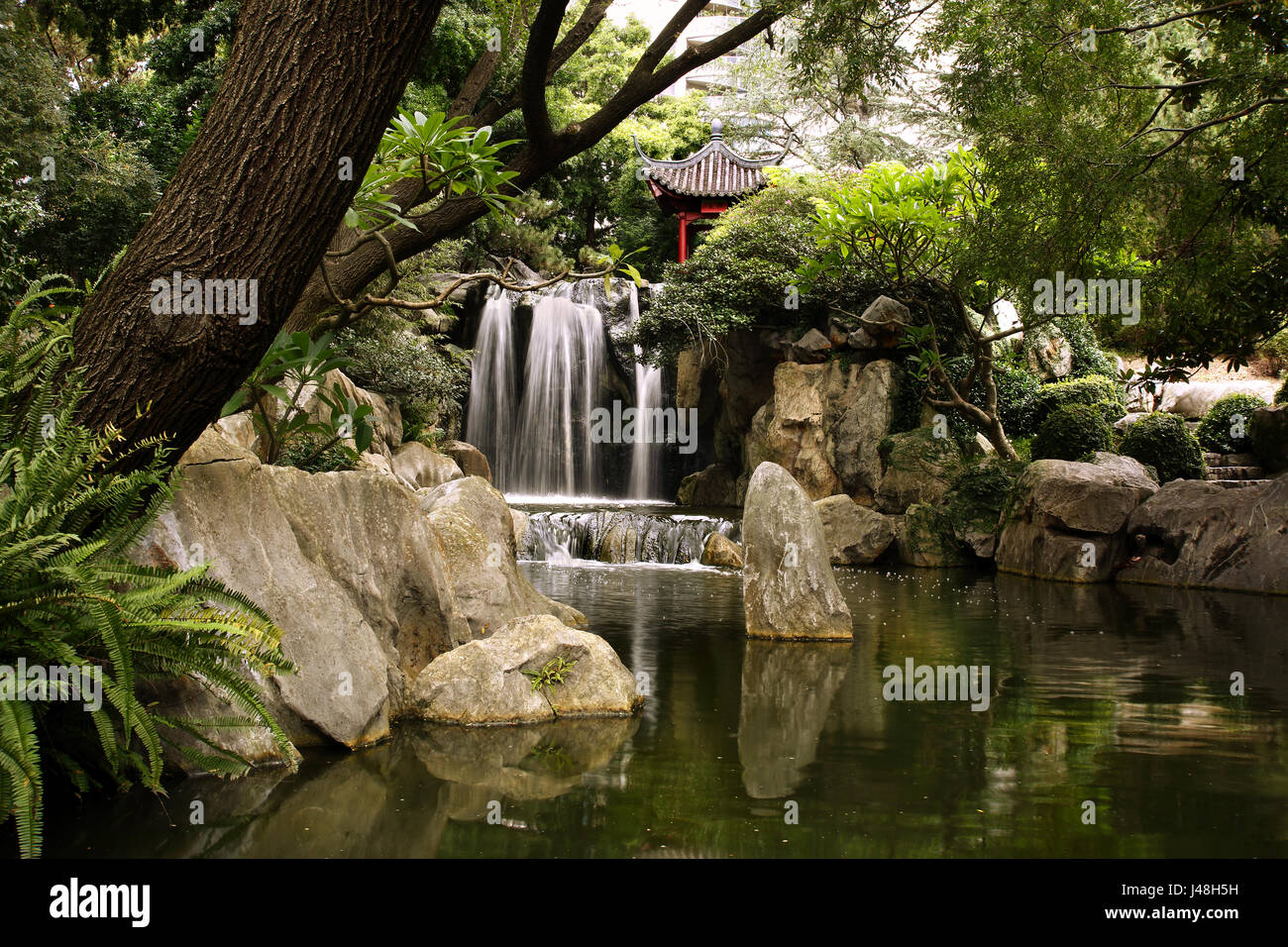 Waterfall and lake at the 'Chinese Garden of Friendship', at Darling Harbour precinct, Sydney, Australia - Stock Image