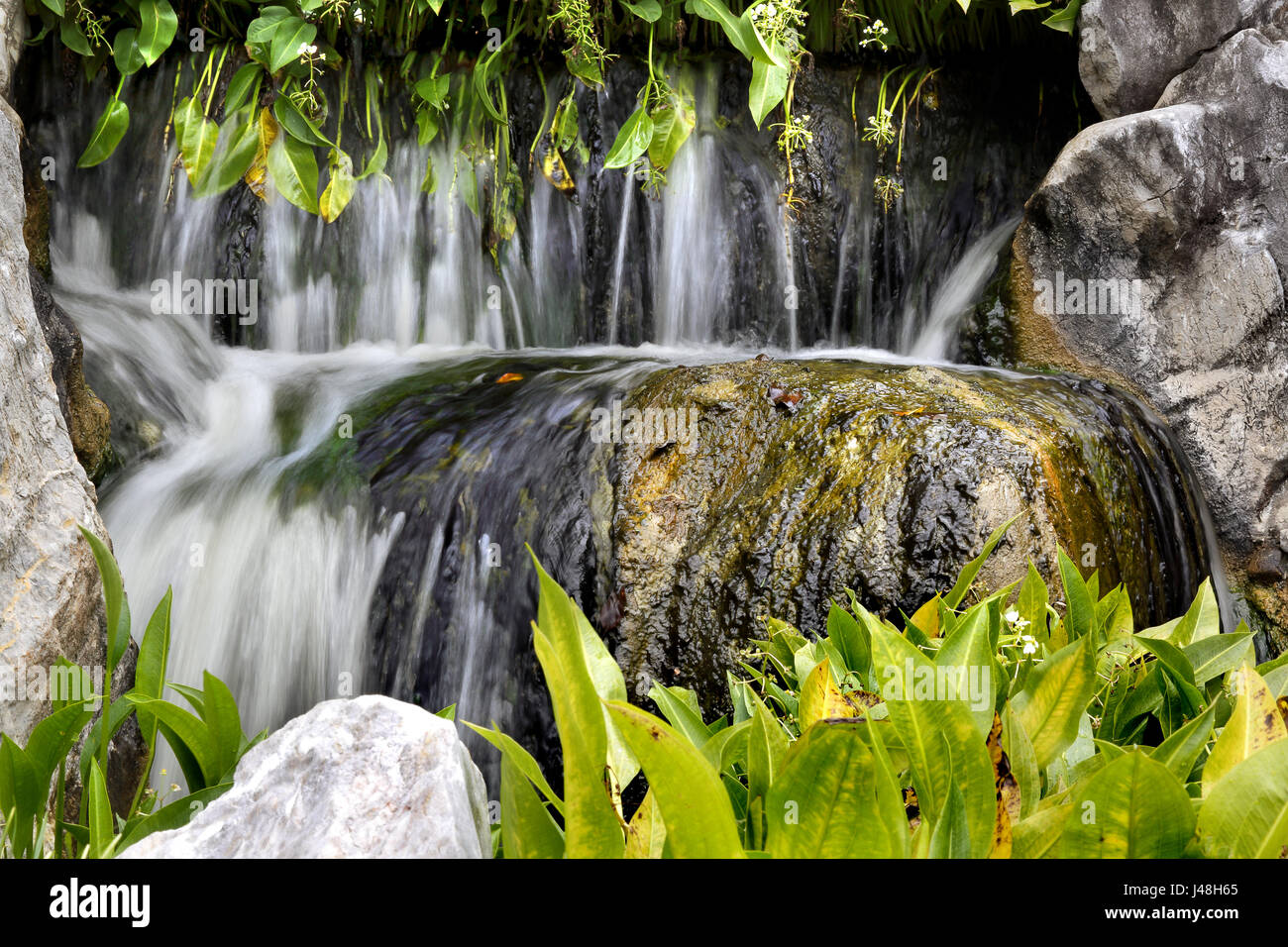 A small waterfall in the 'Chinese Garden of Friendship' in Sydney, Australia - Stock Image