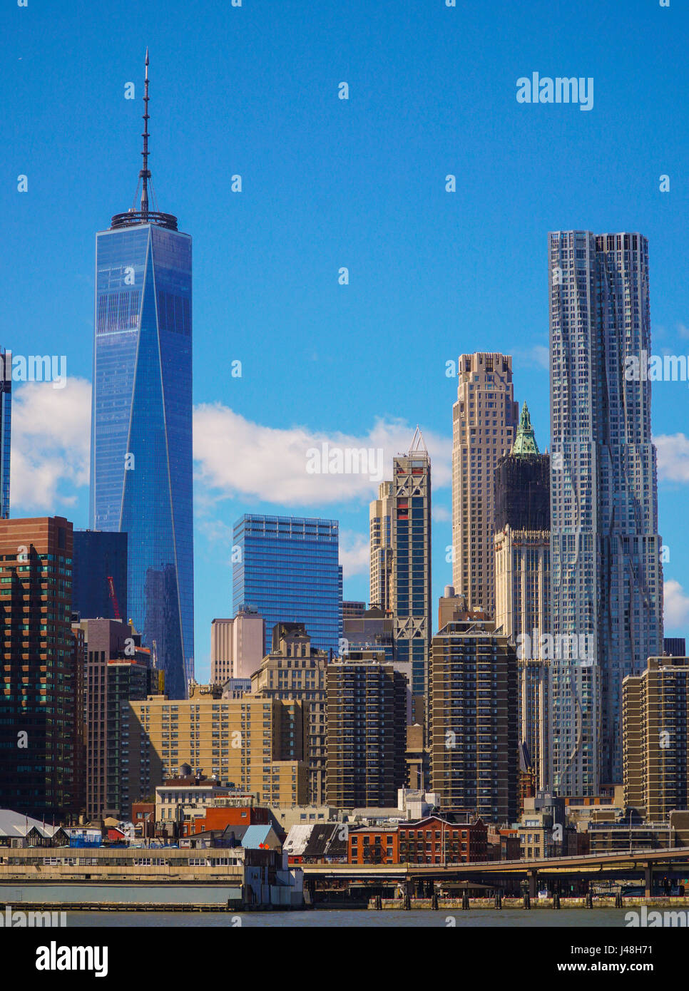 The skyline of Downtown Manhattan financial district with One World Trade Center building- MANHATTAN / NEW YORK - Stock Image