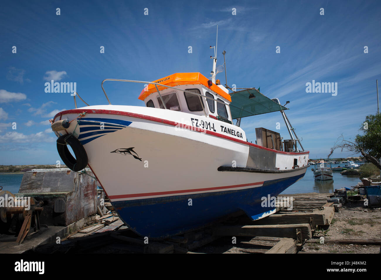 Fishing boat in Fuseta Portugal, ashore, dry dock. - Stock Image