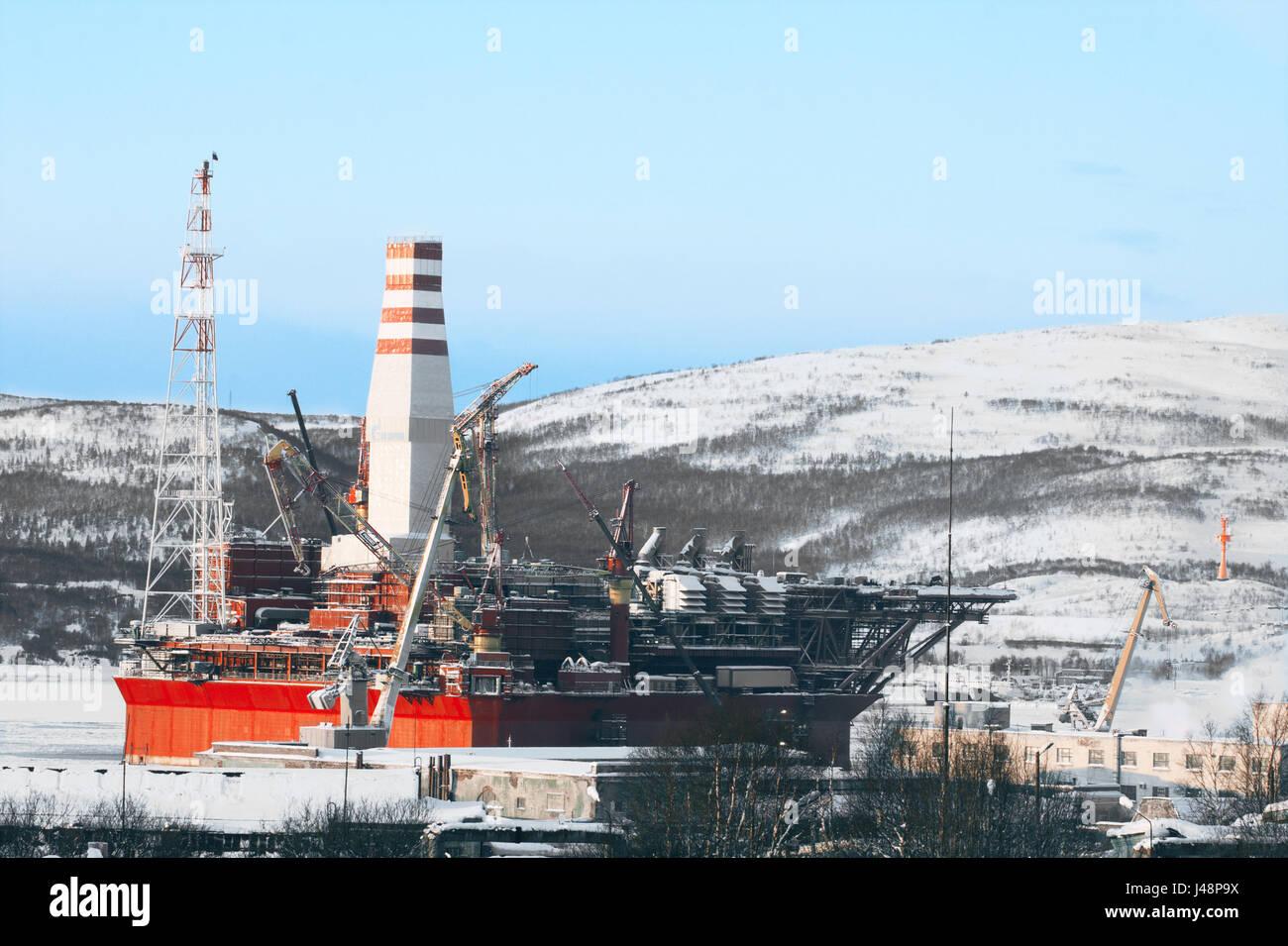 The offshore ice-resistant stationary platform Prirazlomnaya to Shipyard no. 35 outside Murmansk. - Stock Image