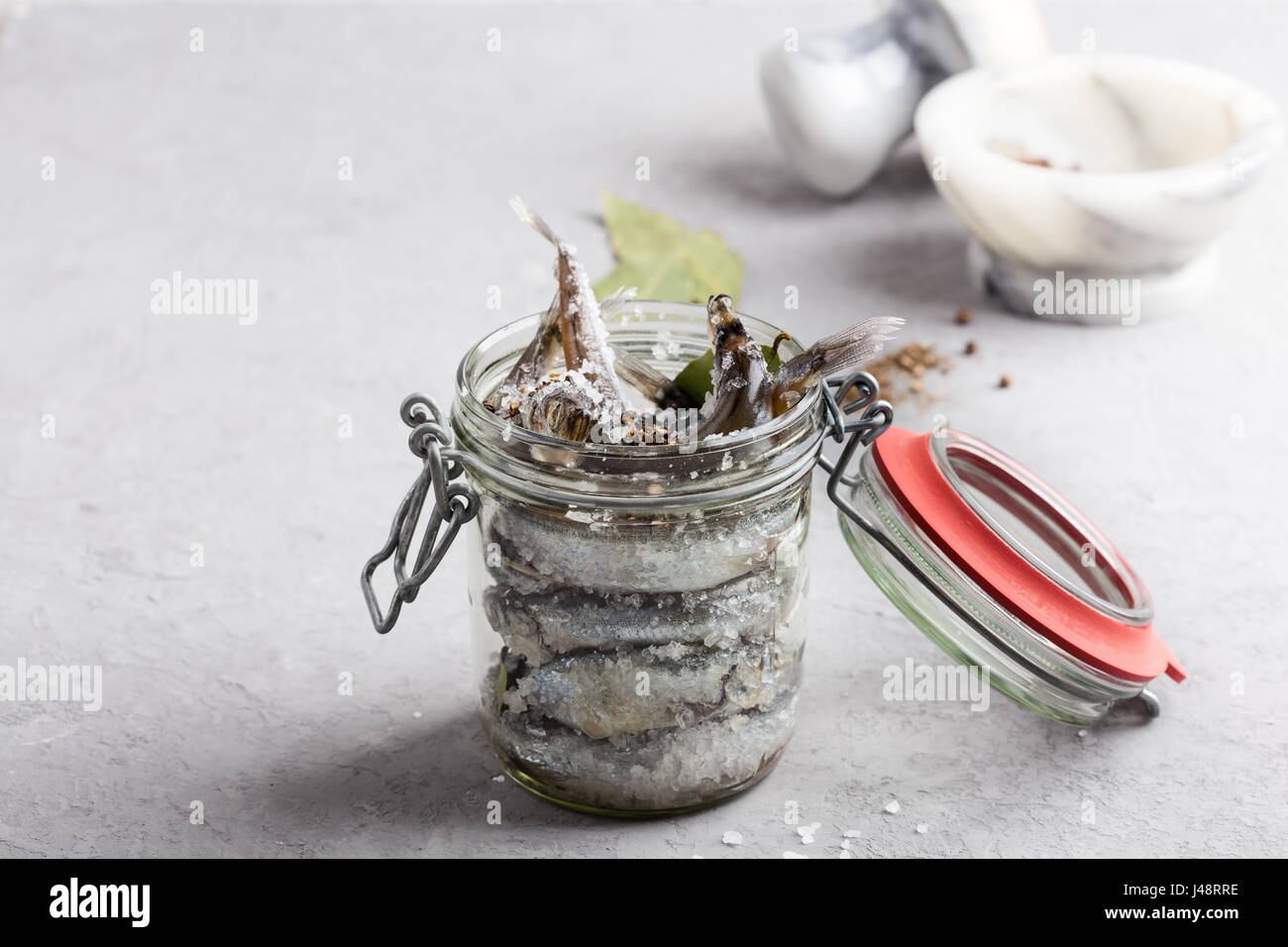 Preparing the salted capelin. Fish preserved for eating Stock Photo