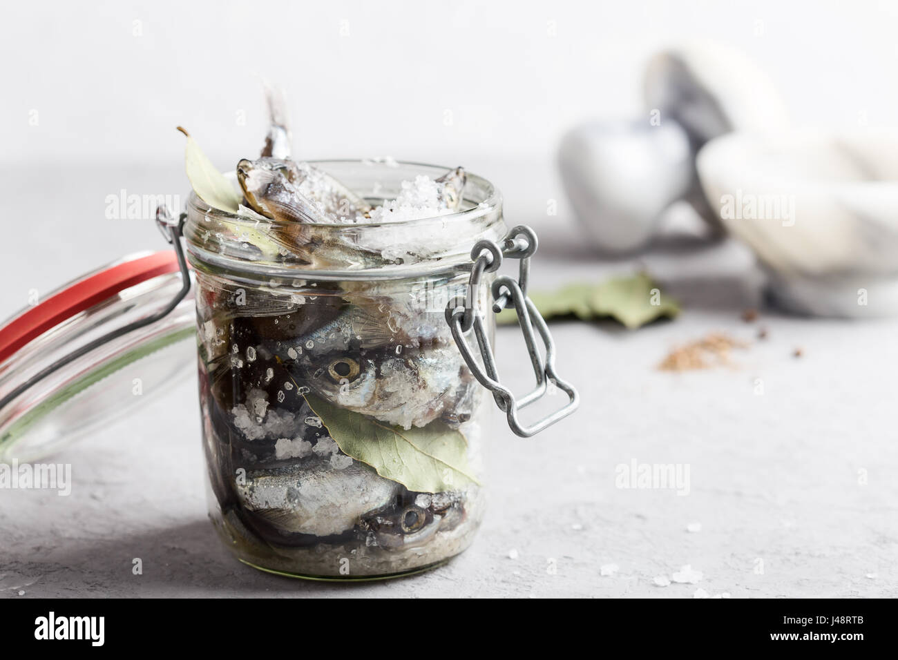Preparing the salted capelin. Fish preserved for eating - Stock Image